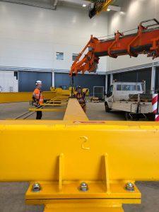 Attaching gantry crane to runner