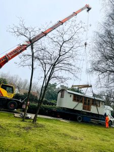 ac45 mobile crane lifting a shepherds hut