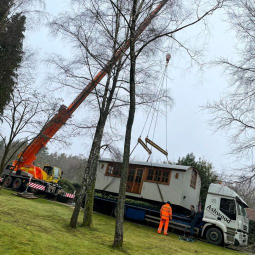 ac45 mobile crane lifting a shepherds hut